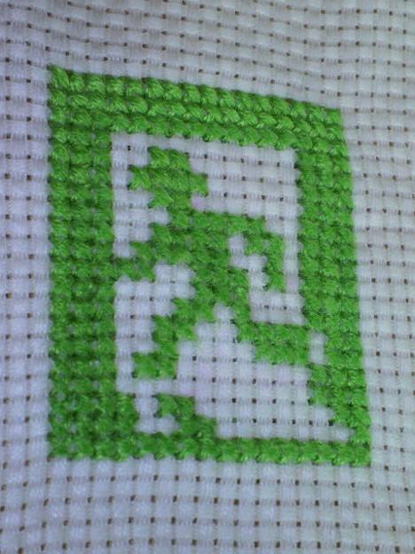 Photos: 非常口の緑の人を刺繍してみた